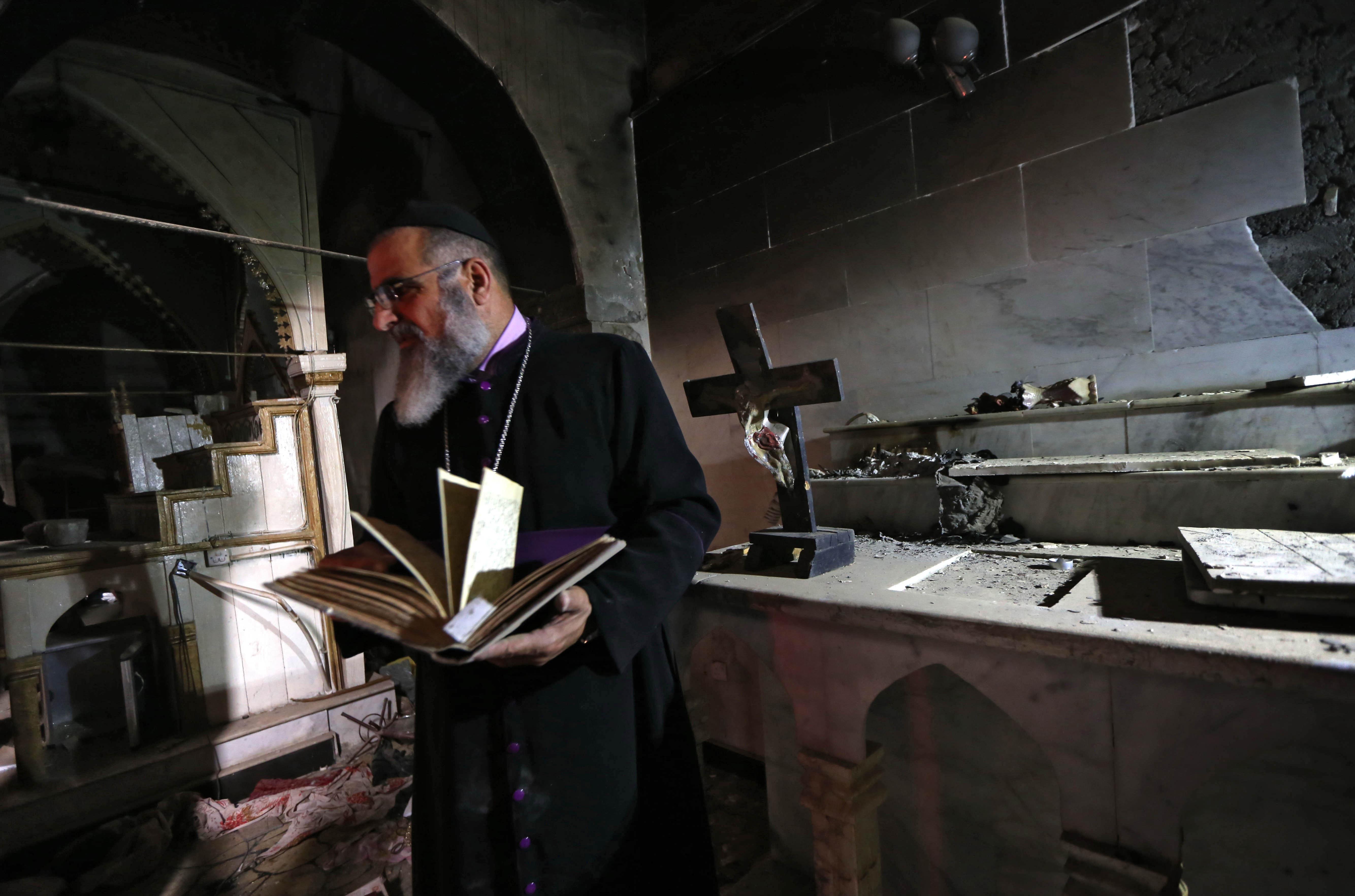 رجل دين مسيحي في برطلة