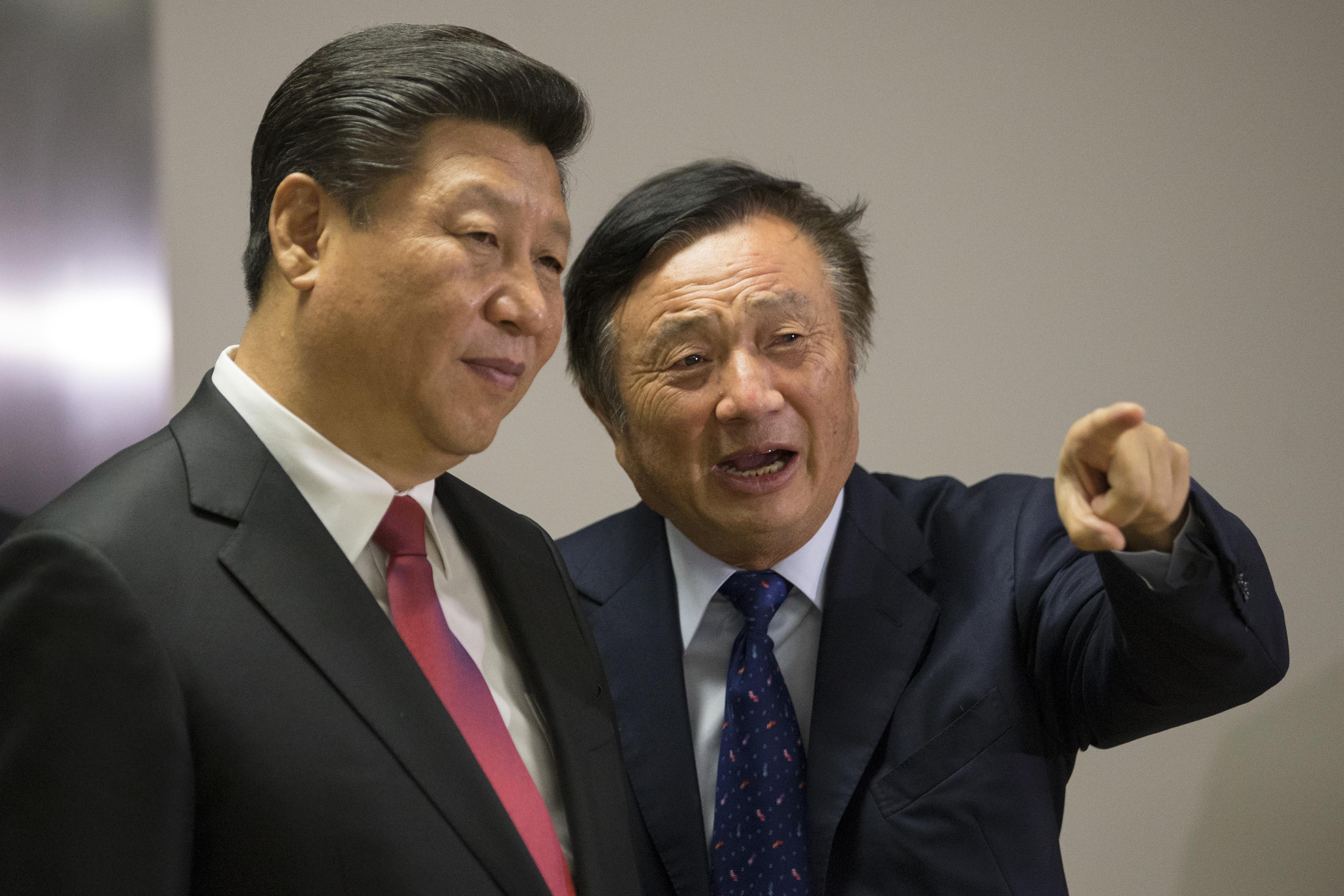 الرئيس الصيني شي بينغ ومؤسس هواوي رين زنغفاي. أرشيفية