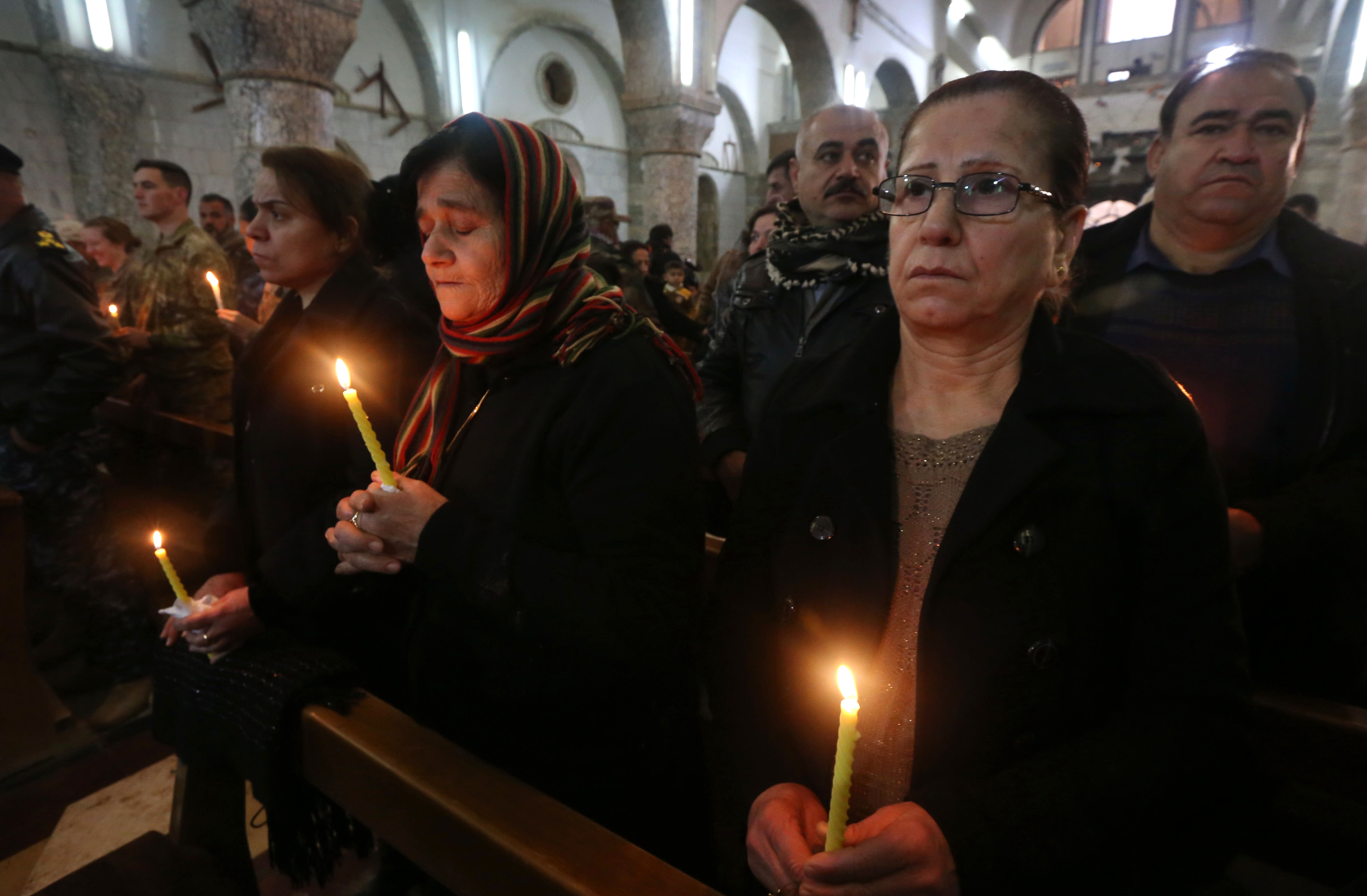 مسيحيون عراقيون في كنيسة مار يوحنا