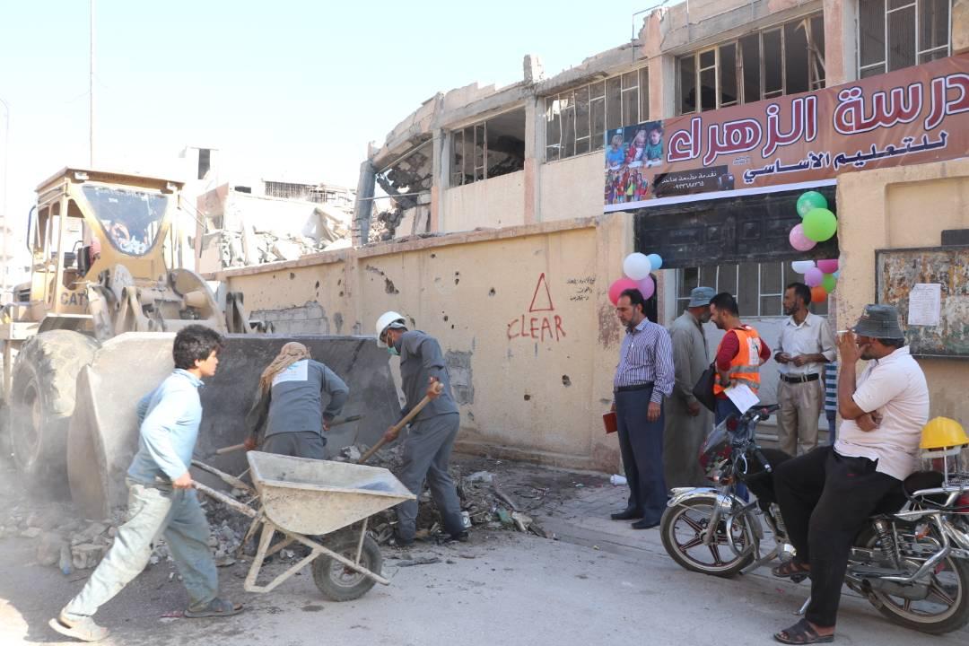 محاولة إصلاحات مستمرة حاليا في المدارس المدمرة في مدينة الرقة السورية
