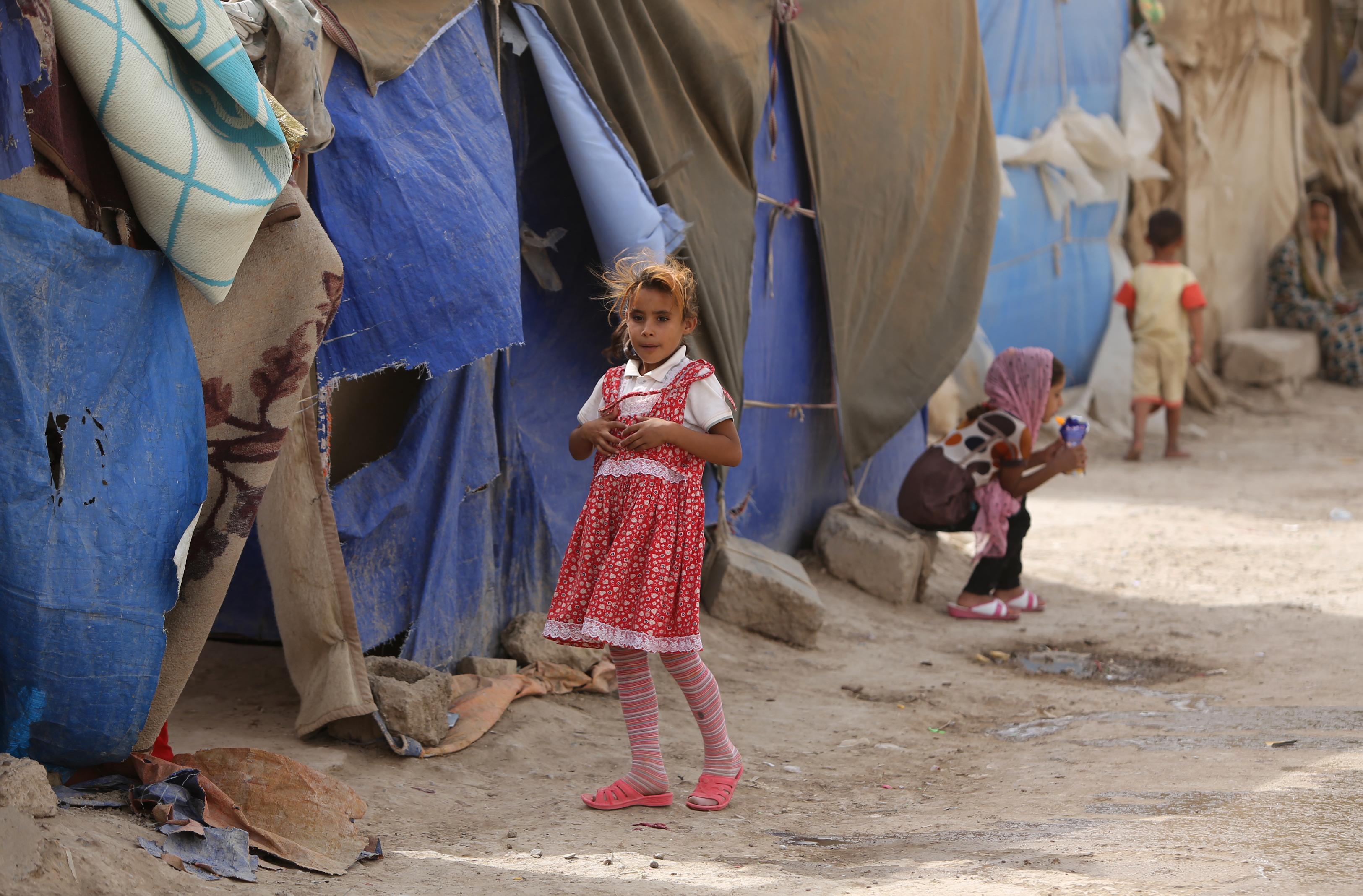 أطفال عراقيون في مخيمات اللجوء