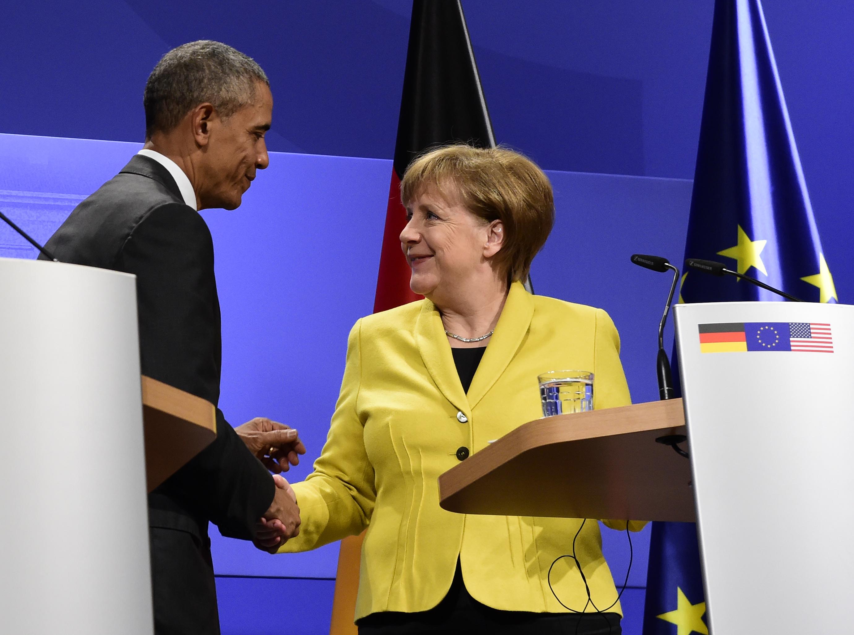 أوباما وميركل خلال مؤتمرهما الصحافي المشترك في هانوفر