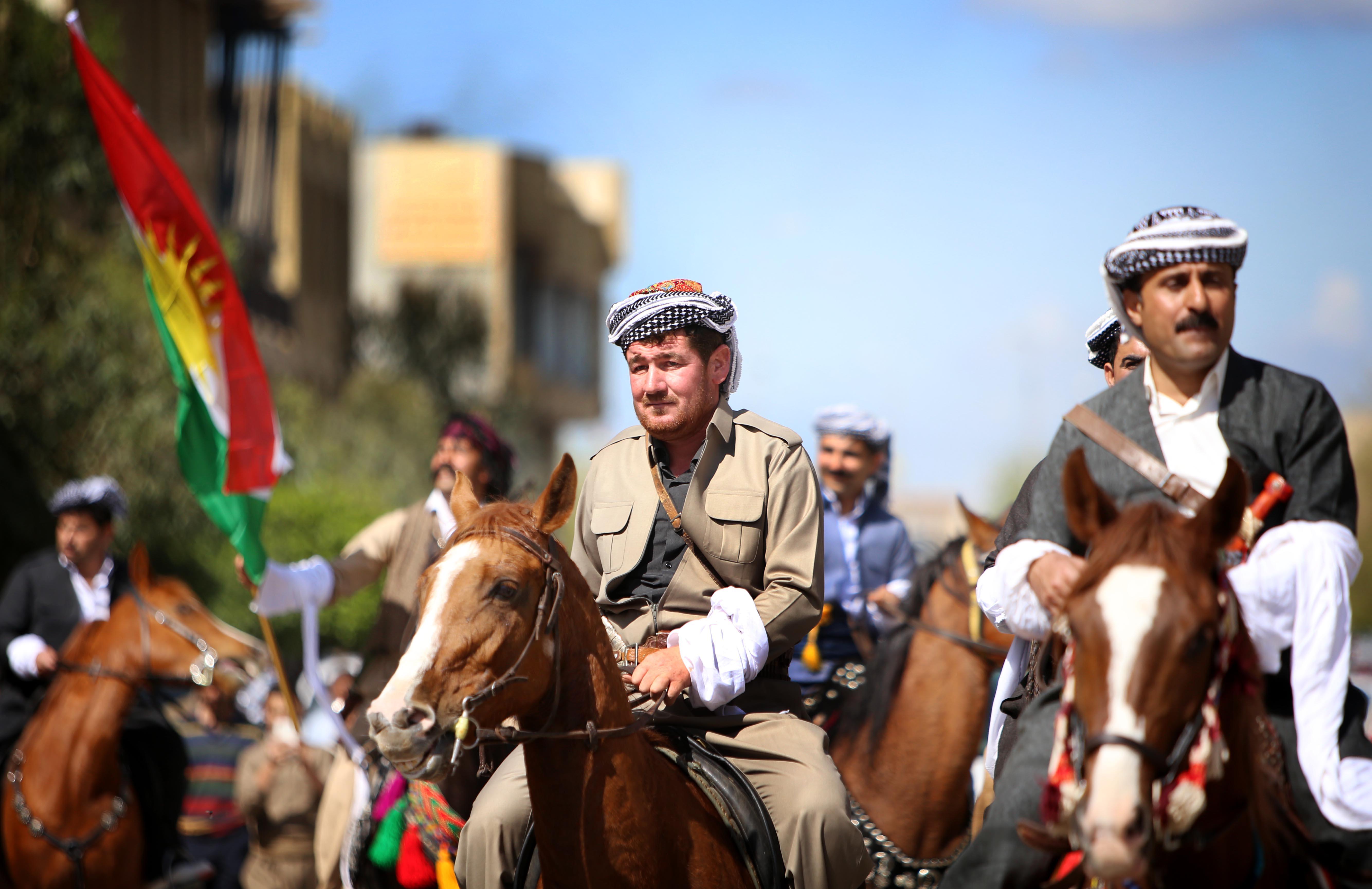 مواطنون أكراد يحيون ذكرى الانتفاضة الكردية في أربيل_ آذار 2014