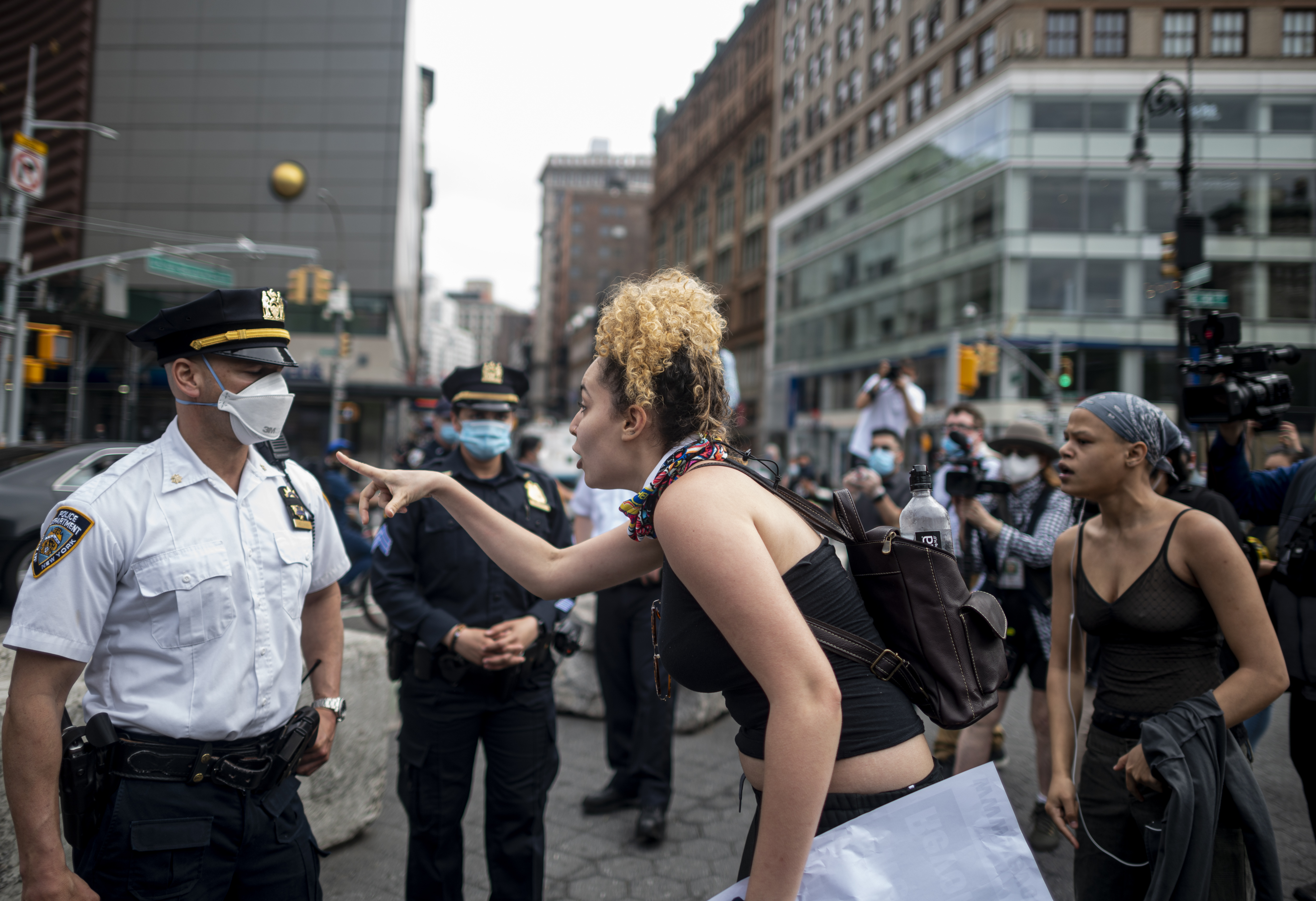 "A protester gestures at an NYPD officer during a ""Black Lives Matter"" demonstration on May 28, 2020 in New York City, in…"