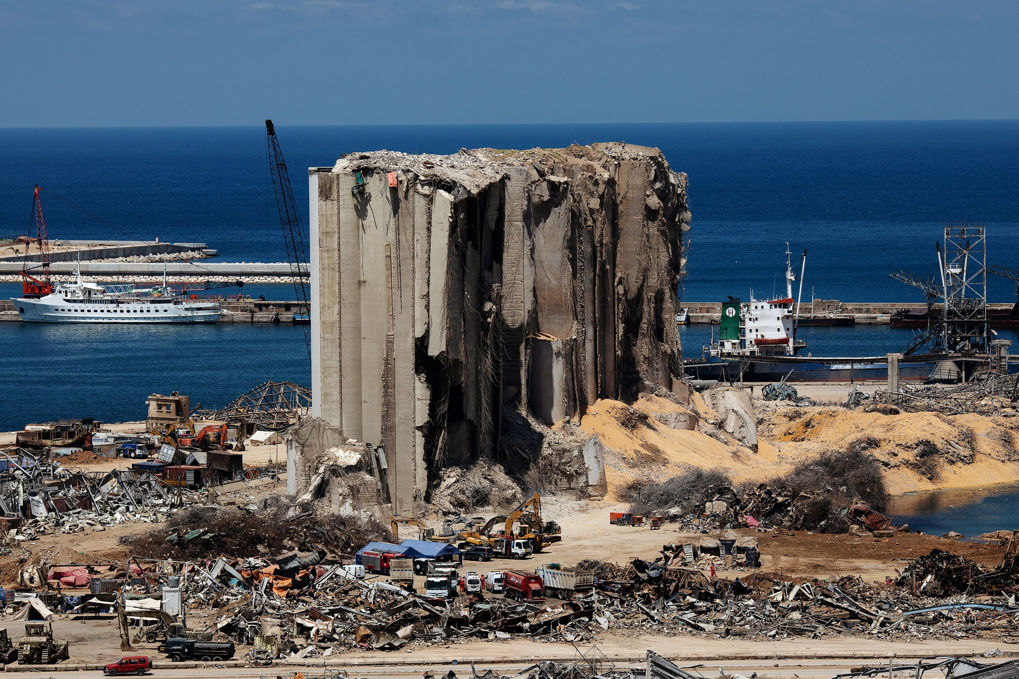 FILE PHOTO: A general view shows the damaged port area in the aftermath of a massive explosion in Beirut, Lebanon, August 17,…