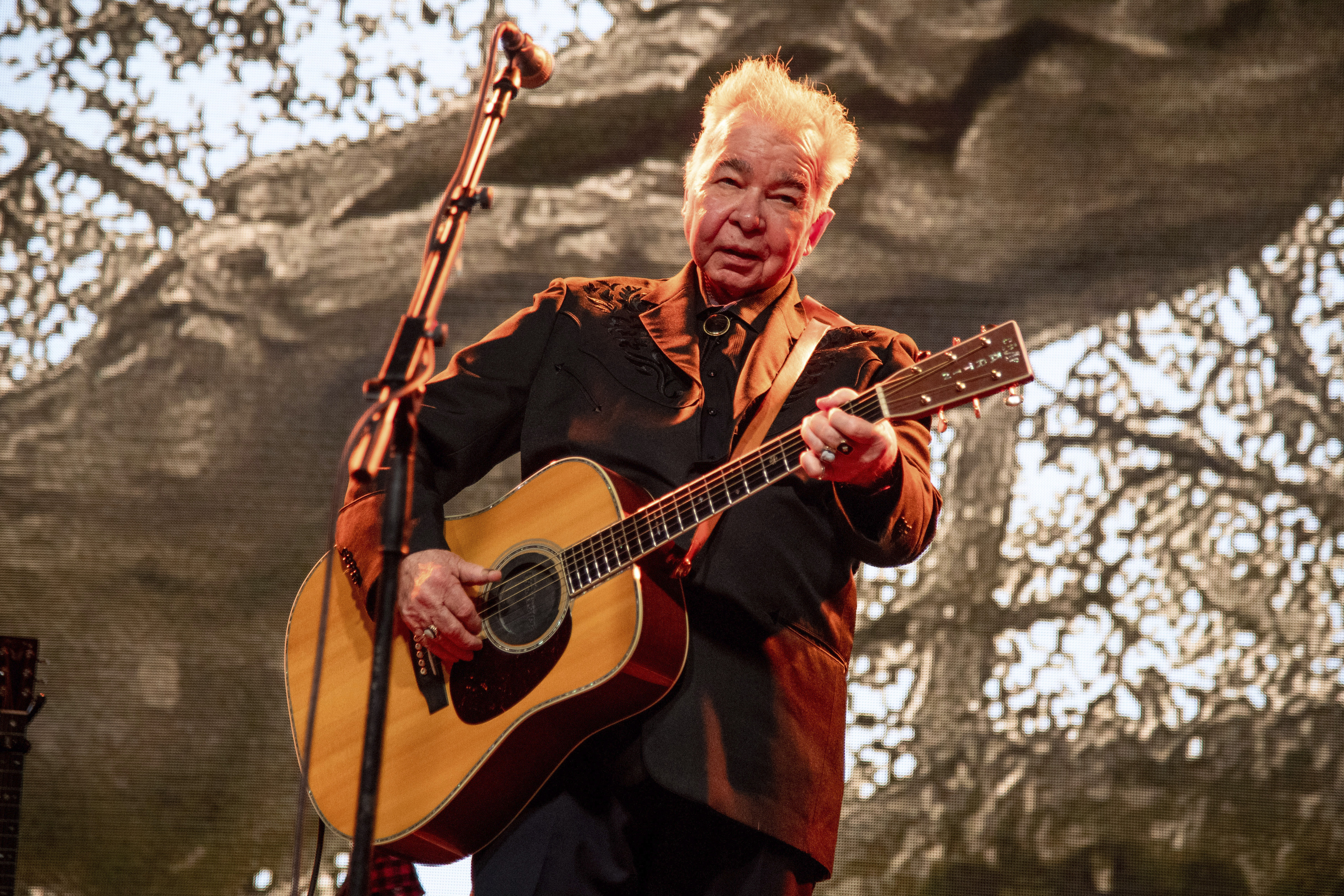 FILE - This June 15, 2019 file photo shows John Prine performing at the Bonnaroo Music and Arts Festival in Manchester, Tenn. …