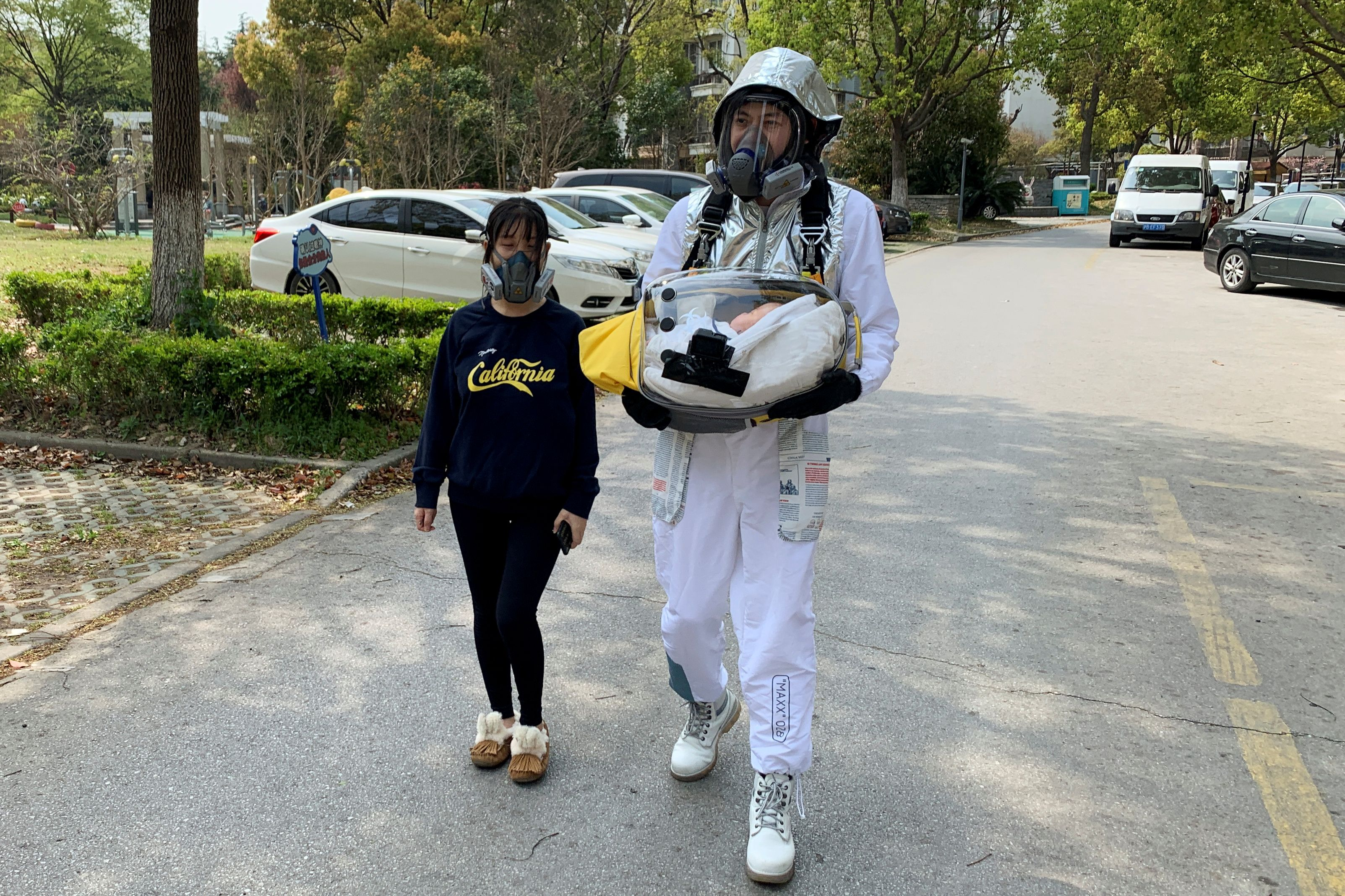 Cao Junjie walks around a residential compound to demonstrate for the camera a safety pod he created to protect his two-month…