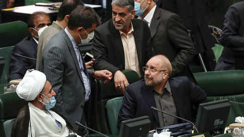 Iranian Mohamad Bagher Ghalibaf (R) talks to members of the parliament after being elected  parliament speaker at the Iranian…