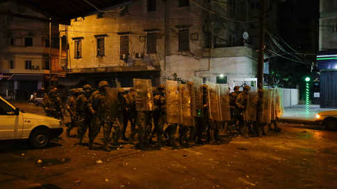 Lebanese army soldiers advance as protesters throw stones amid overnight confrontations in Lebanon's northern city of Tripoli…