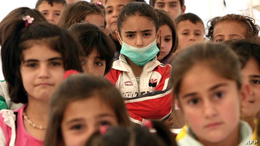 أطفال سوريون لاجئون في مخيم قرب أربيل