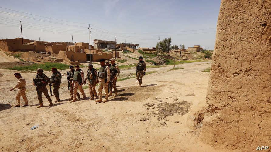 جنود عراقيون في إحدى المناطق المحررة في نينوى