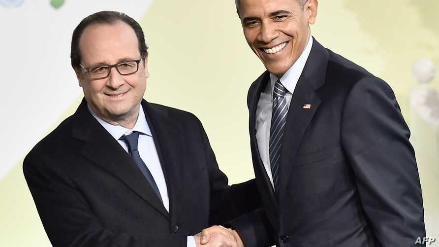 أوباما وهولاند خلال لقاء جمع بينهما في باريس
