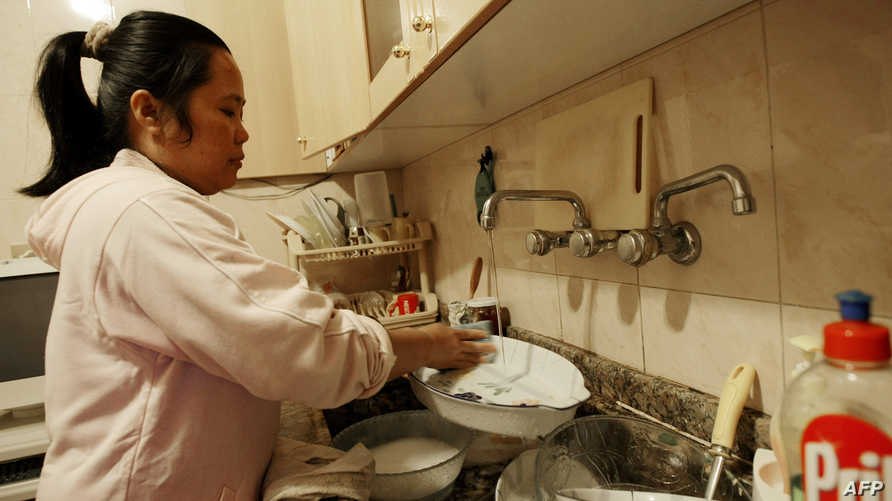غسل الصحون في المنزل-أرشيف