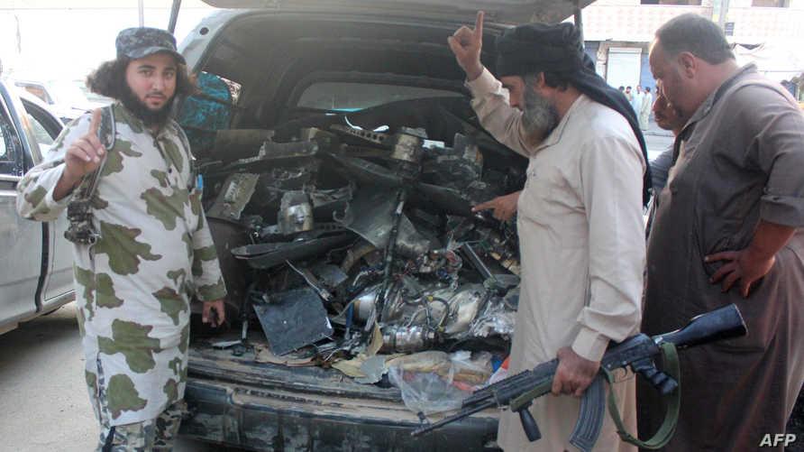 عناصر من تنظيم داعش في الرقة -أرشيف
