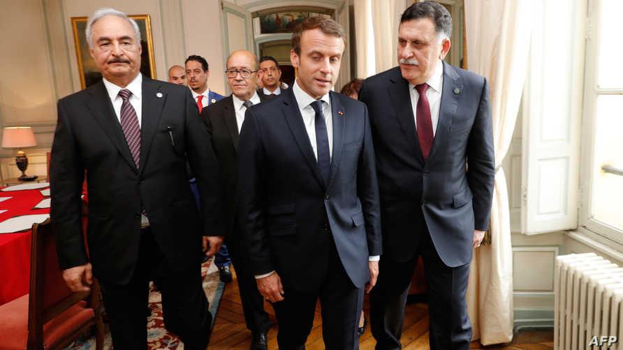 الرئيس الفرنسي إيمانويل ماكرون عقب لقائه بفايز السراج وخليفة حفتر