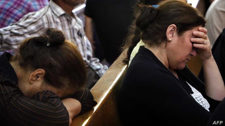 مسيحيون عراقيون في كنيسة في أربيل