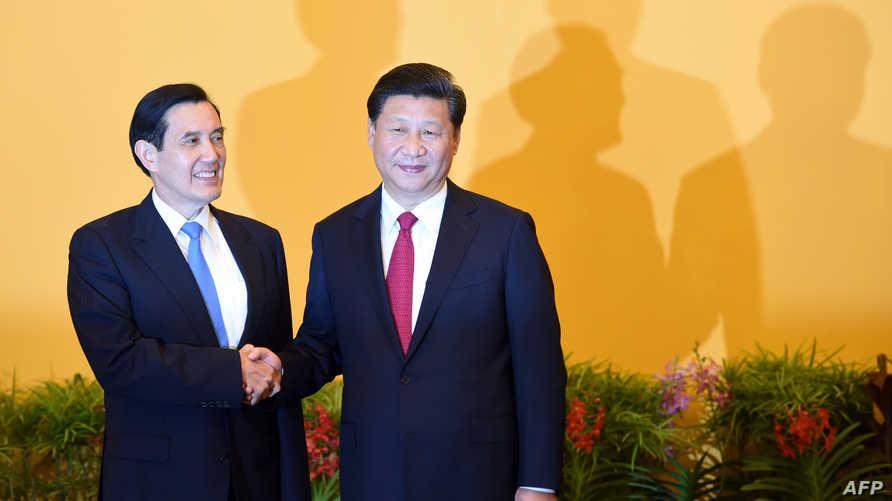 الرئيسان الصيني شي جينبينغ ونظيره التايواني ما يينغ- جيوا