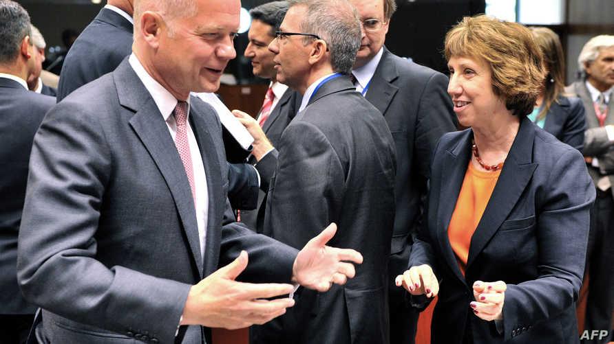 كاثرين آشتون مع وزير الخارجية البريطاني وليام هيغ