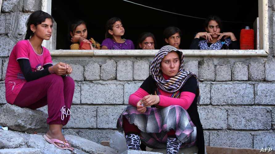 أيزيديات نجحن من الفرار سنجار بعد اقتحام داعش للمنطقة