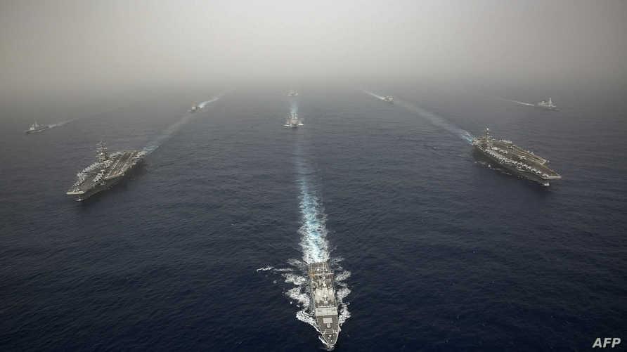 حاملات طائرات أميركية وسفن حربية من بريطانيا وفرنسا وإسبانيا خلال مناورات عسكرية في البحر المتوسط
