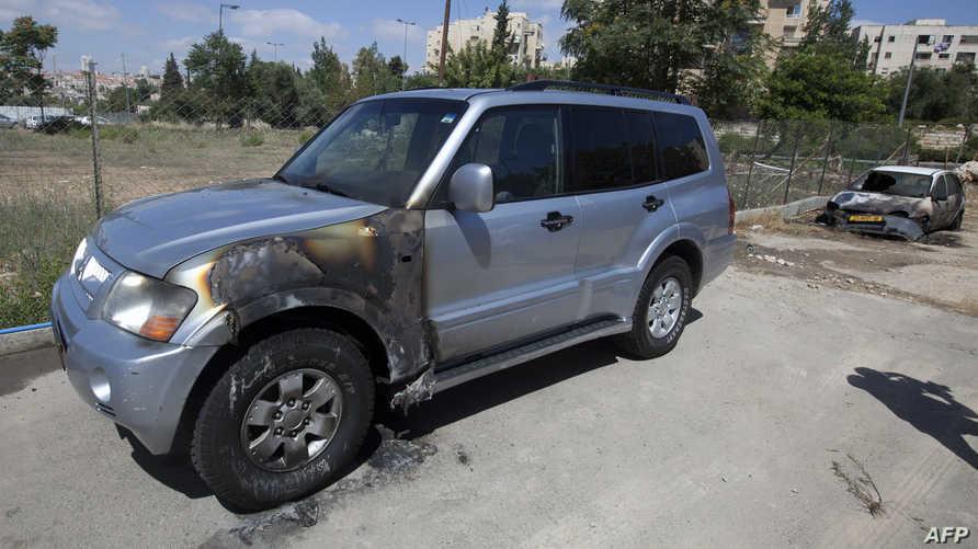 إحدى السيارات التي تعرضت للتدمير