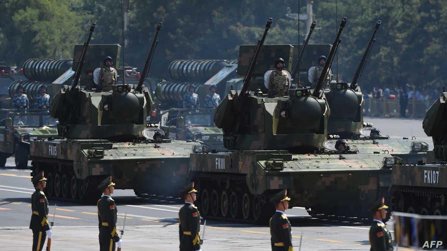 جنود صينيون وآليات تابعة للجيش الصيني- أرشيف