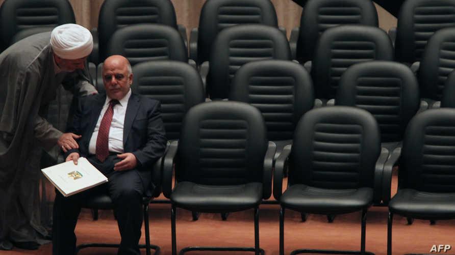 رئيس الوزراء حيدر العبادي في البرلمان يستمع لهمام حمودي نائب رئيس مجلس النواب (أرشيف)