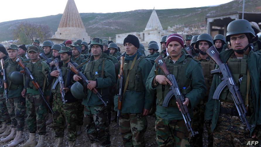 مقاتلون أكراد في سنجار
