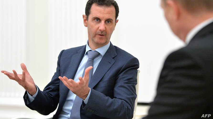 بشار الأسد خلال لقائه بوتين في موسكو