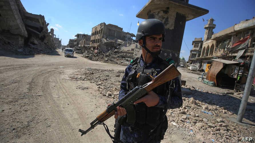 شرطي عراقي في الموصل (أ ف ب)