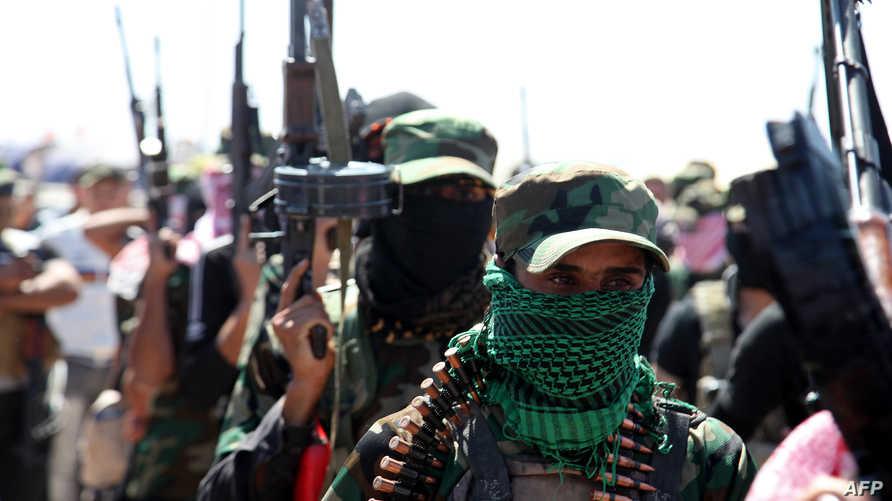 مسلحون ملثمون في العراق- أرشيف