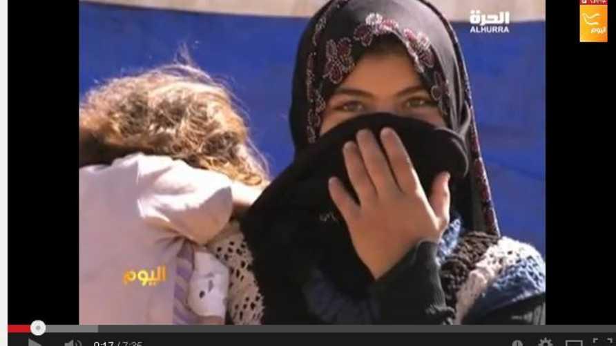 لاجئة سورية وطفلتها