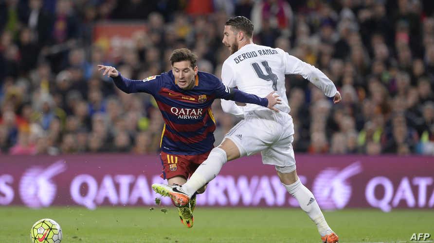 مهاجم برشلونة ليونيل ميسي ومدافع ريال مدريد سيرخيو راموس