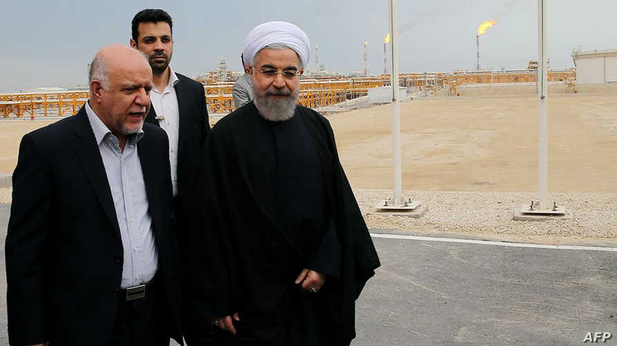 الرئيس الإيراني حسن روحاني مع وزير النفط الإيراني بيجن زنكنه  (أرشيف)