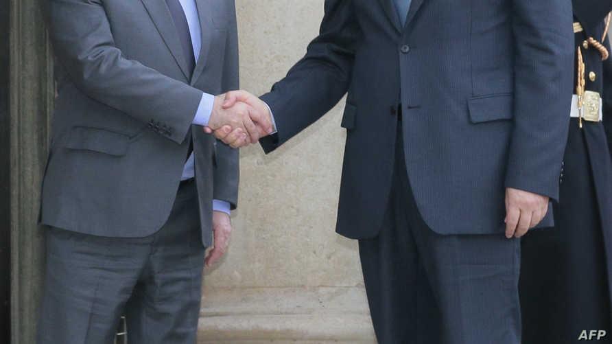 الرئيس الفرنسي فرانسوا هولاند والمعارض السوري رياض حجاب