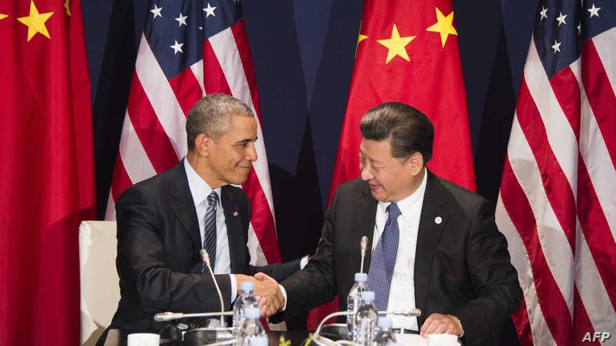 أوباما وشي خلال لقائهما في باريس قبل افتتاح مؤتمر المناخ الشهر الماضي