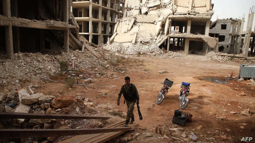 مسلح من المعارضة السورية في إدلب