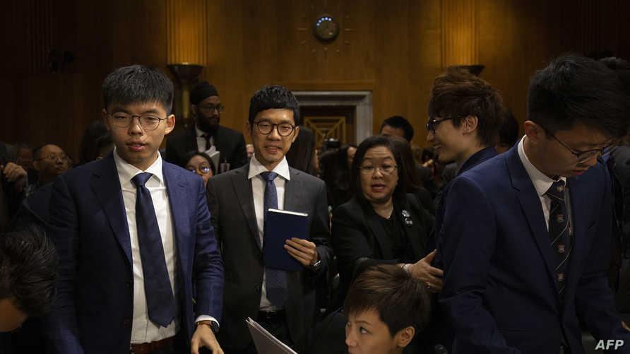 ناشطون من أجل الديمقراطية في هونغ كونغ خلال زيارتهم إلى واشنطن
