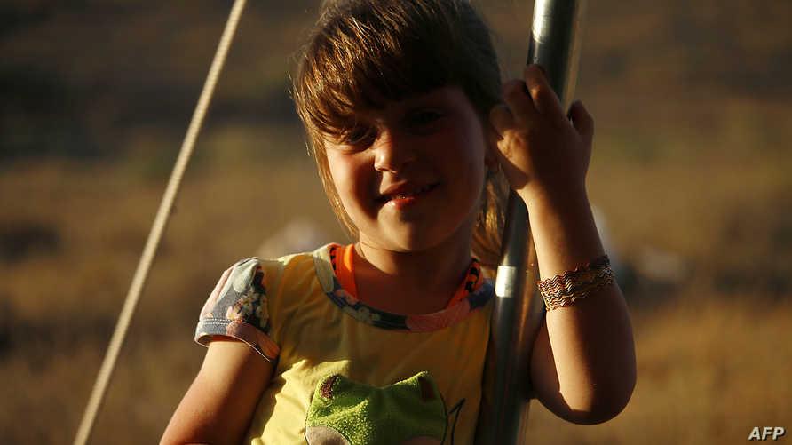 طفلة سورية قرب الحدود مع الأردن