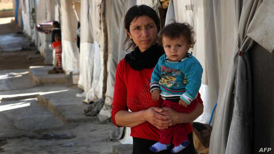 امرأة أيزيدية في أحد المخيمات