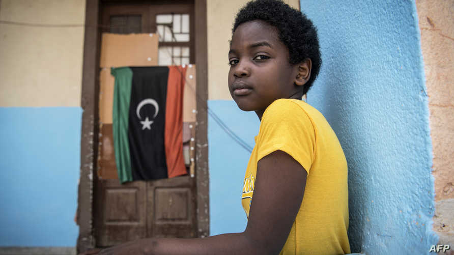 لاجئة سودانية فرت من الاشتباكات بين الأطراف الليبية المتصارعة
