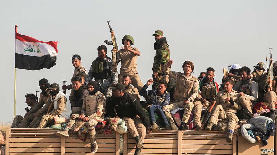 مقاتلون عراقيون مشاركون في عملية تحرير الموصل