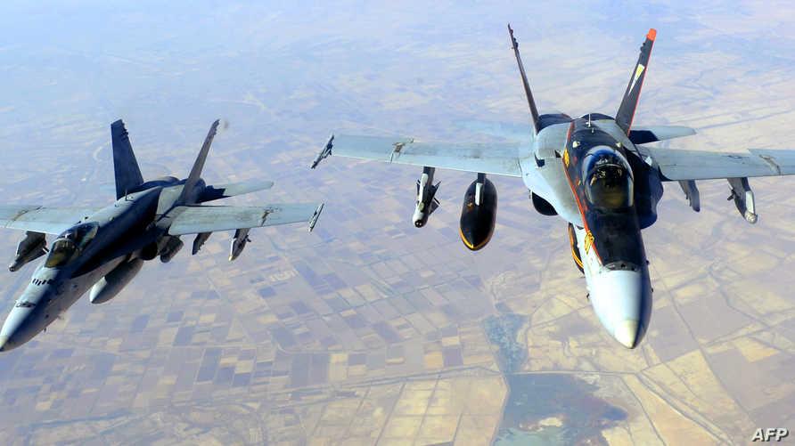 طائرتان أميركيتان من طراز F-18E في مهمة قصف أهداف لداعش في العراق- أرشيف