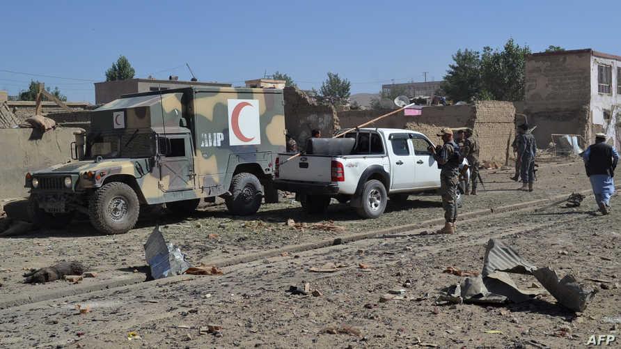 قوة أمنية أفغانية تصل إلى موقع تفجير سيارة مفخخة في غازني شرقي أفغانستان، 7 يوليو 2019