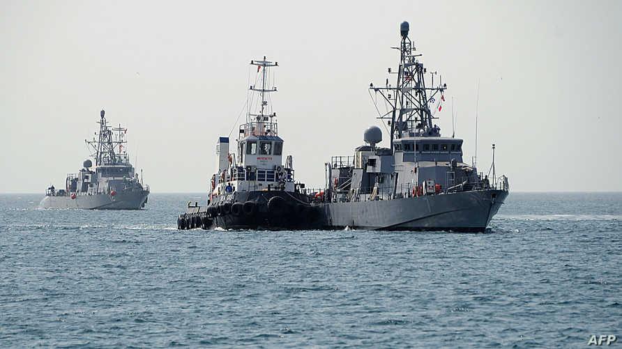 سفينتا USS Thunderbolt (يسار) وUSS Squall (يمين)- أرشيف