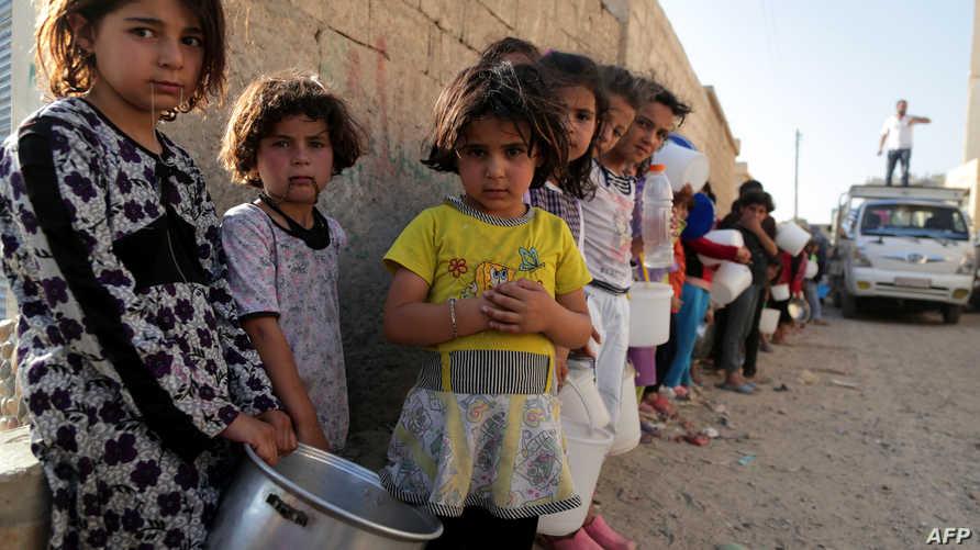 أطفال سوريون في مدينة الرقة