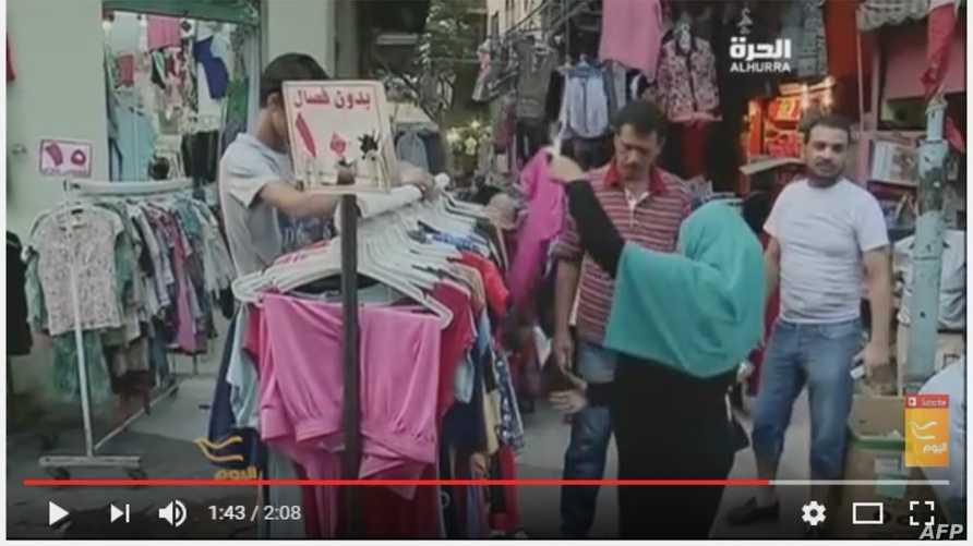 مصريون في سوق الملابس المستعملة