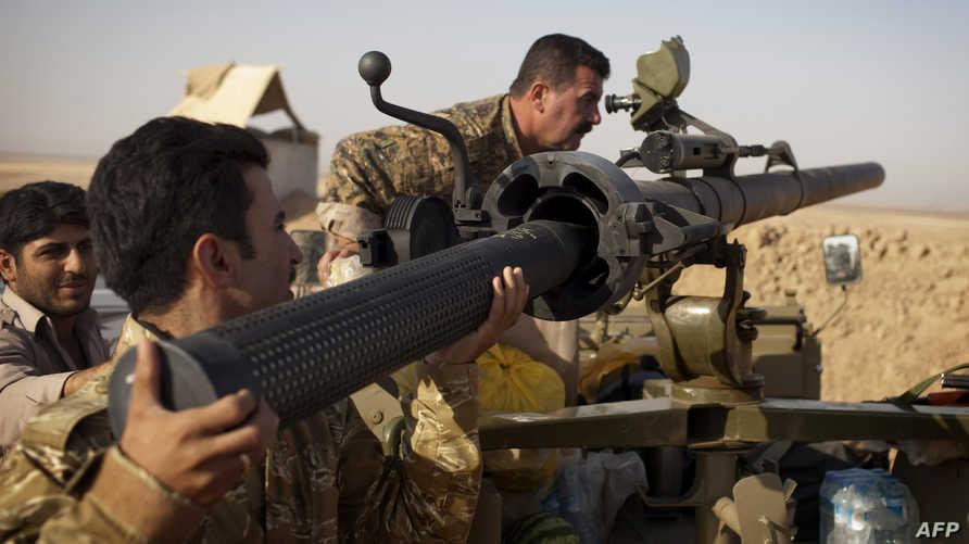 عناصر في البيشمركة خلال اشتباكات مع داعش-أرشيف