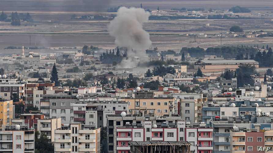 صورة مأخوذة من الجانب التركي لصاروخ سقط على مدينة رأس العين السورية