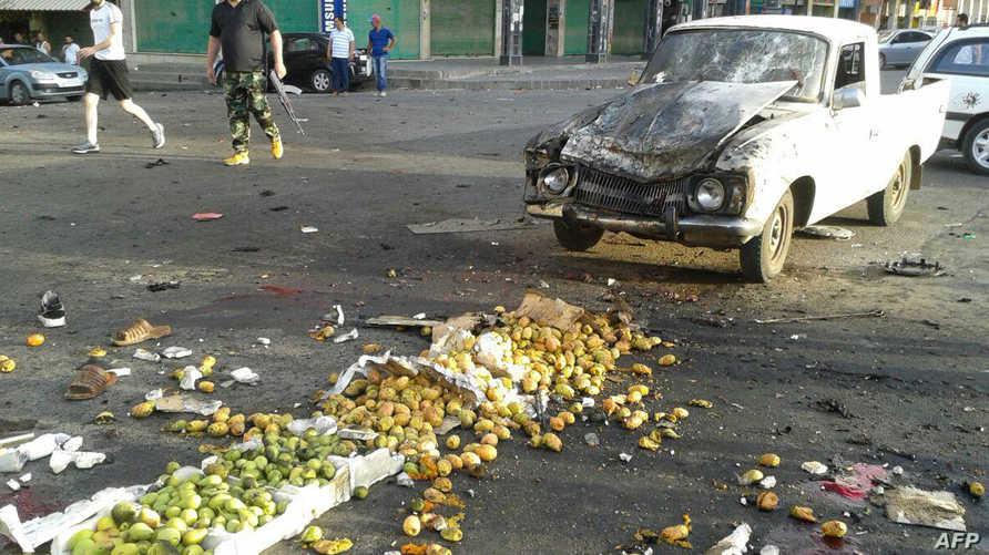 """صور نقلتها """"أ ف ب"""" نقلا عن وكالة """"سانا"""" تظهر التفجيرات التي تسبب بها الأنتحاريين في السويداء"""